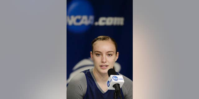 BYU's Lexi Eaton speaks at a news conference ahead of team practice in Lincoln, Neb., Friday, March 28, 2014. BYU will play Connecticut in an NCAA Lincoln Regional women's semifinal basketball game on Saturday. (AP Photo/Nati Harnik)