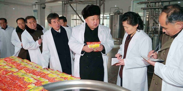 Kim Jong Un gives field guidance to the Pyongyang Children's Foodstuff Factory.