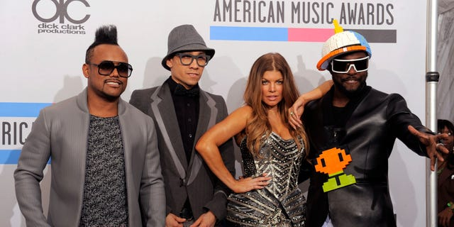 The Black Eyed Peas, from left, Apl.de.ap, Fergie, Taboo, and Will.i.am pose backstage at the 38th Annual American Music Awards on Sunday, Nov. 21, 2010 in Los Angeles. (AP Photo/Chris Pizzello)