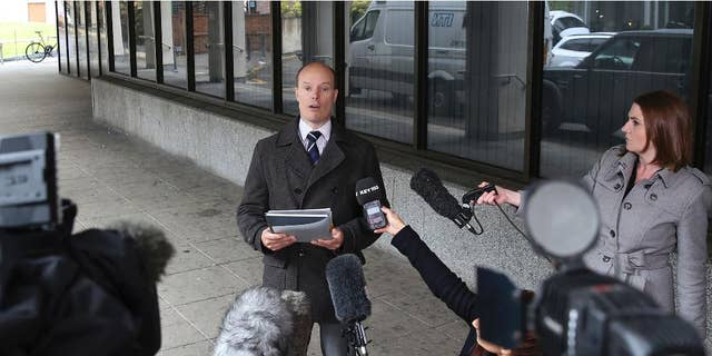 """Ben Southam, Senior Crown Prosecutor from the CPS North West Complex Casework Unit, talks to the media outside Manchester Crown Court, Manchester England, Monday, May 18, 2015,  after nurse Victorino Chua was found guilty by a jury of murdering and poisoning hospital patients at Stepping Hill Hospital. A medical mystery that began four years ago with unexplained deaths in a British hospital ended Monday when a """"frustrated"""" nurse was convicted of using insulin to murder two patients. The 49-year-old nurse, a father of two daughters, was also convicted of trying to poison 20 other patients during what police called a reign of terror at Stepping Hill Hospital in Stockport, 200 miles (320 kilometers) northwest of London. (Peter Byrne/PA via AP) UNITED KINGDOM OUT"""