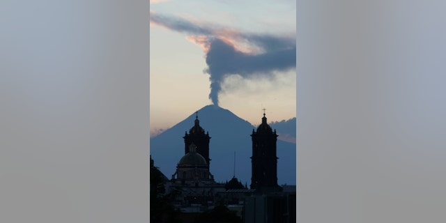 April 14, 2012: A plume of steam rises from the Popocatepetl volcano seen from the city of Puebla, Mexico.