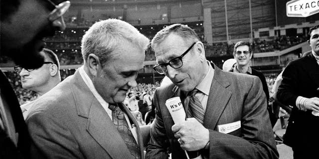 FILE - In this March 27, 1971, file photo, Villanova University basketball coach Jack Kraft, left, congratulates UCLA coach John Wooden after Wooden's Bruins defeated Villanova, 68-62, to win the NCAA championship in Houston, Texas.