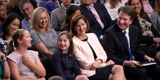 Kavanaugh, shown here with his wife, Ashley Estes Kavanaugh, and their two young daughters, Margaret and Liza.
