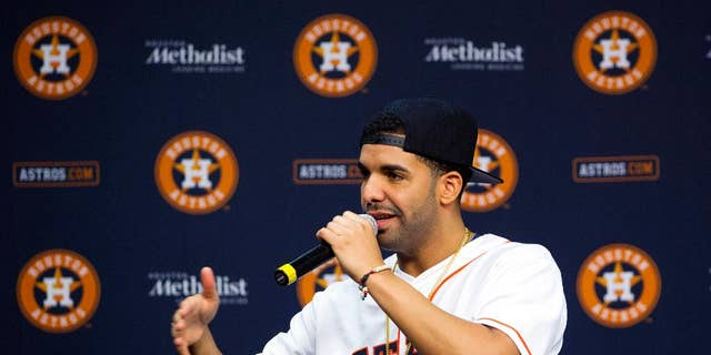 Grammy Award-winning artist Drake speaks at a press conference before a baseball game against the Arizona Diamondbacks and the Houston Astros, Thursday, June 12, 2014, in Houston.  (AP Photo/Patric Schneider)