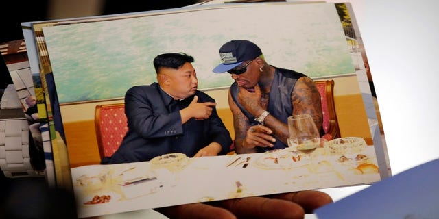 Dennis Rodman showed pictures of his visit to North Korea, including one in which he's seen speaking with Kim Jong Un.