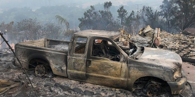 This early Saturday, July 7, 2018, photo shows the damage to vehicles and buildings off Fairview Ave., in Goleta, Calif.