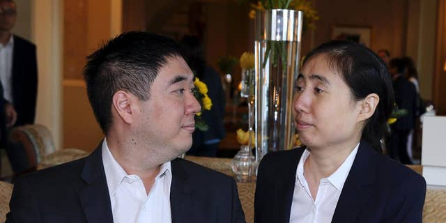 October 19, 2014: American couple Grace and Matthew Huang, sentenced to jail over charges they starved their 8-year-old adopted daughter to death, talk before they meet with U.S. Ambassador to Qatar, Dana Shell Smith, at a hotel in Doha. (AP Photo/Osama Faisal)