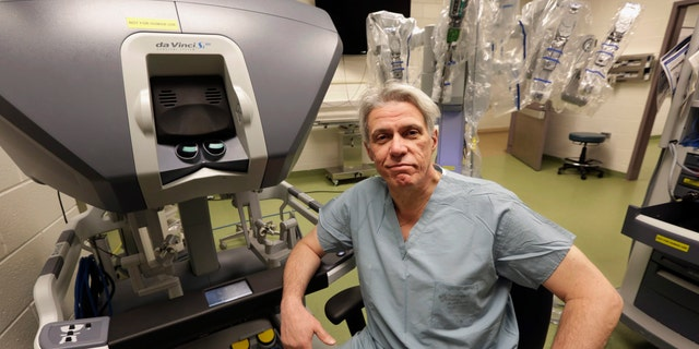 Dr. Pier Giulianotti, chief of minimally invasive and robotic surgery at the University of Illinois Hospital & Health Sciences System in Chicago, sits at the control panel of the da Vinci robot system.