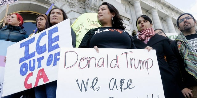 California's sanctuary state legislation, which takes effect Jan. 1, would ban police from asking people about their immigration status or participating in federal immigration enforcement activities.