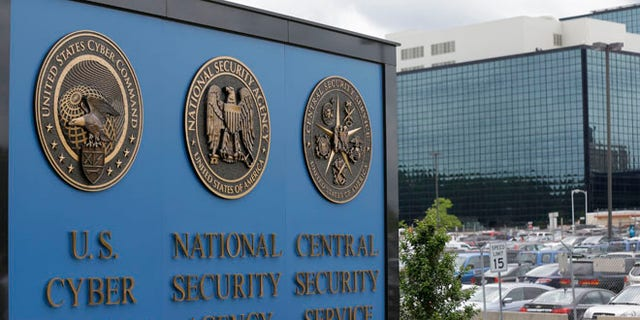 FILE - This June 6, 2013, file photo shows the sign outside the National Security Agency campus in Fort Meade, Md. A presidential advisory panel has recommended dozens of changes to the government's surveillance programs, including stripping the NSA of its ability to store Americans' telephone records and requiring a court to sign off on the individual searches of phone and Internet data. (AP Photo/Patrick Semansky, File)