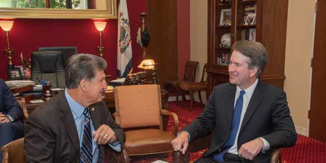 Supreme Court nominee Brett Kavanaugh meets with West Virginia Democratic Sen. Joe Manchin on Monday.