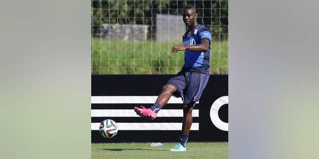 Italy's Mario Balotelli kicks the ball during a training session in Mangaratiba, Brazil, Tuesday, June 17, 2014. Italy plays in group D at the 2014 soccer World Cup. (AP Photo/Antonio Calanni)