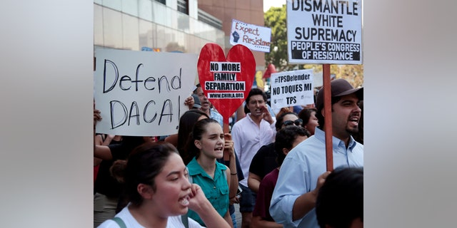 Supporters of the Deferred Action for Childhood Arrivals (DACA) program recipient during a rally outside the Federal Building in Los Angeles, California, U.S., September 1, 2017. REUTERS/Kyle Grillot - RC18E3C6C9D0