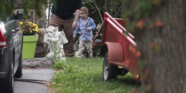 Joshua Boyle and his son Jonah played in the garden  at his parents house in Ontario, on Saturday, Oct. 14, 2017.