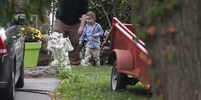 Joshua Boyle and his son Jonah play in the garden at his parent's house in Ontario.