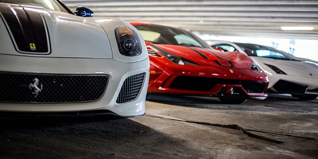 There is over a million dollars worth of cars in this photo alone.
