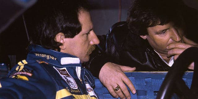 Driver Dale Earnhardt (L) and car owner Richard Childress are deep in conversation at a NASCAR Cup race, circa 1985. Earnhardt brought the Wrangler sponsorship to Childress racing in 1984 and began a relationship that lasted until 2001, earning the team six Cup championships. (Photo by ISC Images & Archives via Getty Images)