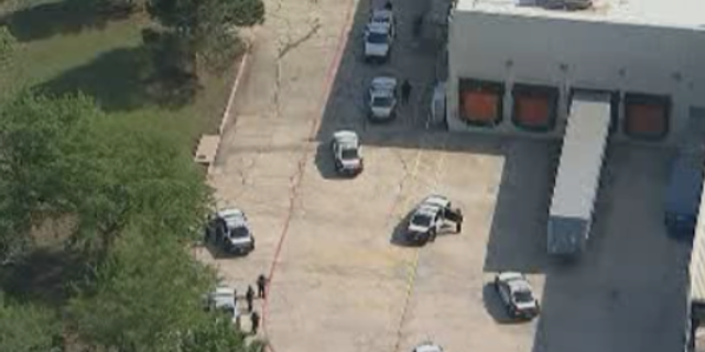 Authorities were reportedly searching a wooded area behind the store for the suspect.