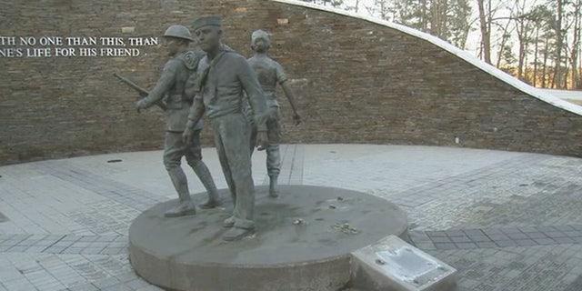 The damaged Walk of Heroes War Veterans Memorial in Conyers, Ga.