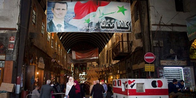 Even as the war encroaches on the capital, people in Damascus go about their business.
