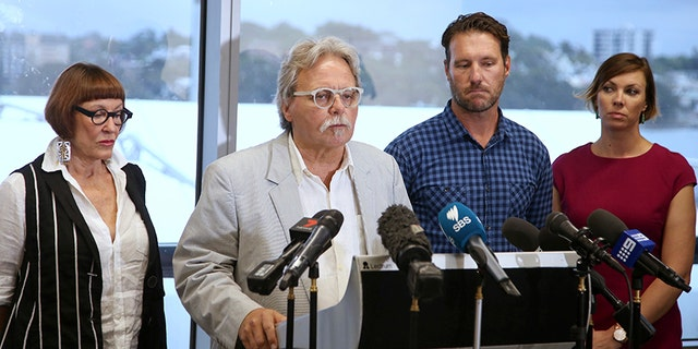 Dec. 21, 2017: John Ruszczyk, second from left, making a statement in Sydney.
