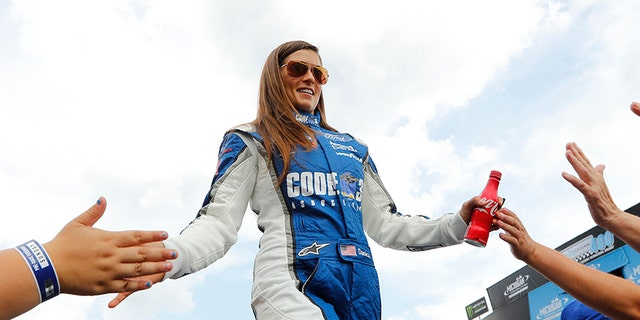 Danica Patrick greets fans before the NASCAR Cup Series auto race in Brooklyn, Mich., Sunday, Aug. 13, 2017. (AP Photo/Paul Sancya)