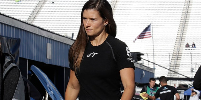 Danica Patrick walks to her garage prior to practice for the NASCAR Cup Series 300 auto race at New Hampshire Motor Speedway in Loudon, N.H., Saturday, Sept. 23, 2017. (AP Photo/Charles Krupa)