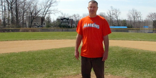 April 6, 2015: Christopher Stefanoni poses at the Darien Little League park in Darien, Conn. Stefanoni is suing the Darien Little League in federal court, saying league officials demoted his 9-year-old son to a lower-level team as retribution for his affordable housing proposal. Lawyers for the Little League deny the allegations.
