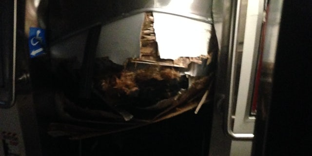 The collapsed roof inside the first train car.