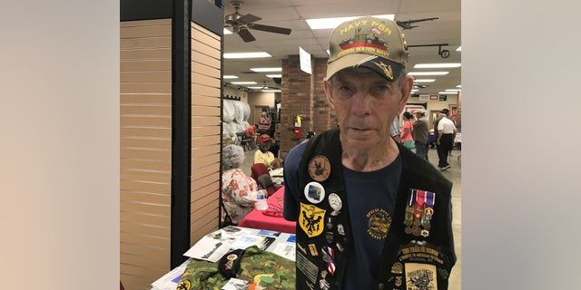 Vietnam veteran David Larsen was one of several former service members on hand to speak to members of the public about wartime experiences during the Trail of Honor event in Jackson, Miss.