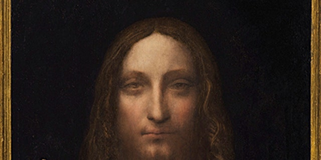 """""""Salvator Mundi,"""" an ethereal portrait of Jesus Christ which dates to about 1500, is on display for the media at Christie's auction in New York."""