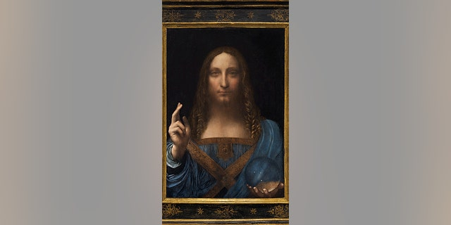 """Salvator Mundi,"" an ethereal portrait of Jesus Christ which dates to about 1500, is on display for the media at Christie's auction in New York."