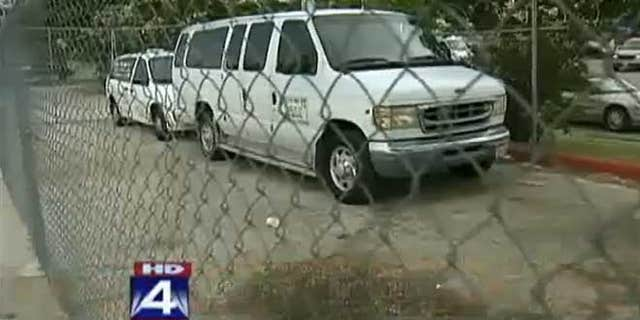 Vans outside Little T's Tiny Tots day care facility.