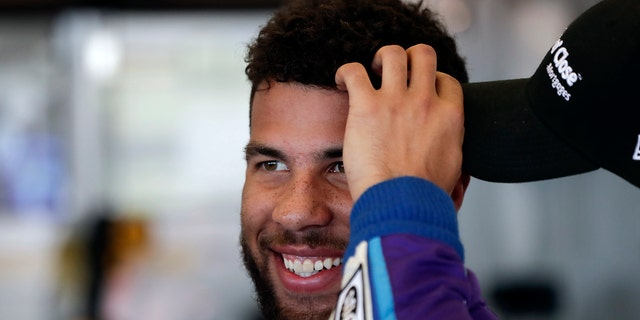 Darrell Wallace Jr. relaxes in his garage during practice for the NASCAR Daytona 500 auto race at Daytona International Speedway, Saturday, Feb. 17, 2018, in Daytona Beach, Fla.