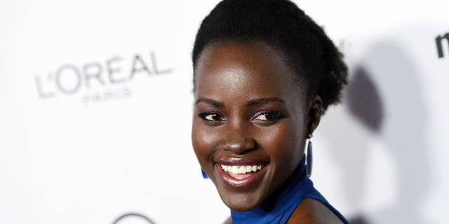 """FILE - In this Jan. 12, 2016 file photo, actress Lupita Nyong'o poses at the Marie Claire Image Maker Awards in Los Angeles. Following a second straight year of all-white acting Oscar nominees, Nyong'o said Tuesday, Jan. 19, on Instagram she was joining in """"calling for change in expanding the stories that are told and recognition of the people who tell them."""" (Photo by Chris Pizzello/Invision/AP, FIle)"""