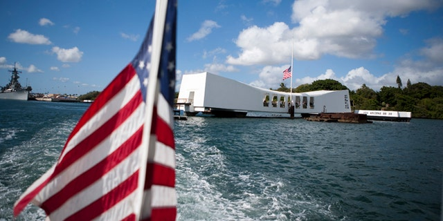 FILE - This Dec. 7, 2011 file photo shows the USS Arizona Memorial in Pearl Harbor, Hawaii. This popular site at Pearl Harbor is actually a grave, a resting place for crew members who died in the Pearl Harbor attack of Dec. 7, 1941. Visitors can see it on a first-come, first-serve basis, and many do to see a significant piece of history and pay respects to those who died.  (AP Photo/Marco Garcia, file)