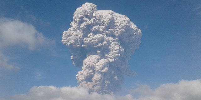 Mount Sinabung spews volcanic ash as it erupts in Karo, North Sumatra, Indonesia, Monday, Feb. 19, 2018.