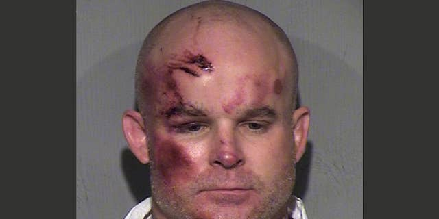 FILE - This undated file booking photo provided by the Maricopa County Sheriff's Office shows Ryan Giroux, 41, who Mesa police say committed a string of crimes that included a motel shooting, a carjacking and a home invasion that ended with the suspect's arrest on Wednesday, March 18, 2015. Giroux pleaded not guilty on Monday, April 6, 2015 to killing one person and wounding five others in a suburban Phoenix rampage that included multiple shootings, a carjacking and a home invasion. (AP Photo/Maricopa County Sheriff's Office,File)