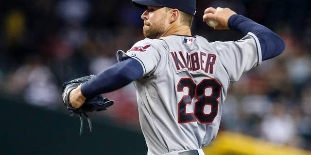 Cleveland Indians' Corey Kluber throws a pitch to the Arizona Diamondbacks during the first inning of a baseball game Wednesday, June 25, 2014, in Phoenix. (AP Photo/Ross D. Franklin)