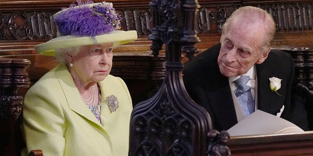 Queen Elizabeth II and Prince Phillip at St. George's Chapel at Windsor Castle for the wedding of Meghan Markle and Prince Harry.