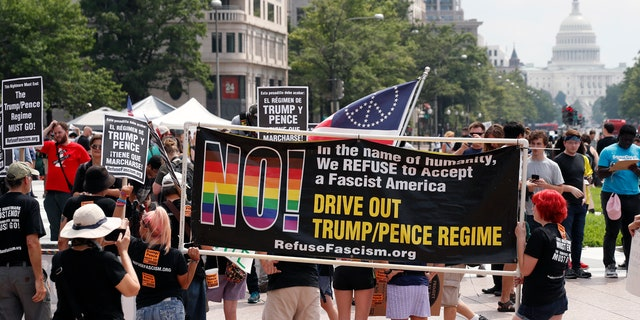 Counterprotesters rally in Freedom Plaza on Pennsylvania Avenue in Washington D.C. Sunday.