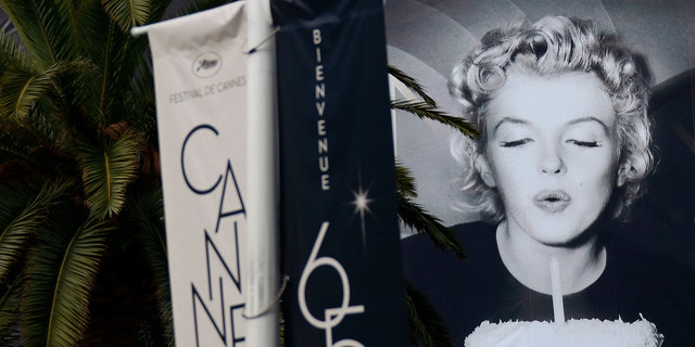File photo: The official poster of the 65th Cannes Film Festival featuring U.S. actress Marilyn Monroe is seen on the facade of the Festival Palace in Cannes May 14, 2012. (REUTERS/Eric Gaillard)