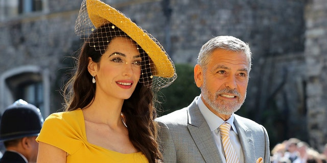 Amal and George Clooney head to the ceremony at St. George's Chapel.