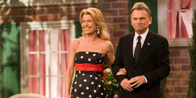 "Vanna White, a South Carolina native, and Pat Sajak, co-hosts of the television show ""Wheel of Fortune"" greet the crowd on the set in South Carolina in 2007."