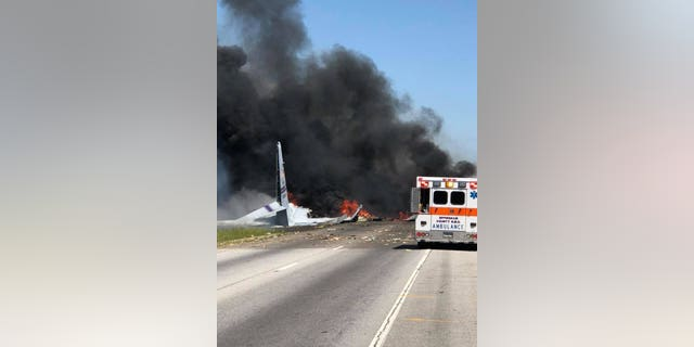 Flames and smoke rise from an Air National Guard WC-130 cargo plane after it crashed near Savannah, Ga., Wednesday, May 2, 2018.