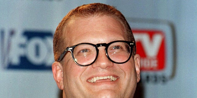 Actor Drew Carey poses with the TV Guide's Editors' Award he received because of his influence in shaping the quality of today's television programming at the first annual TV Guide Awards February 1 on the Fox Studio lot in Los Angeles. The awards were determined by readers of TV Guide magazine who voted for their favorite television shows and stars. - RTXIQDO