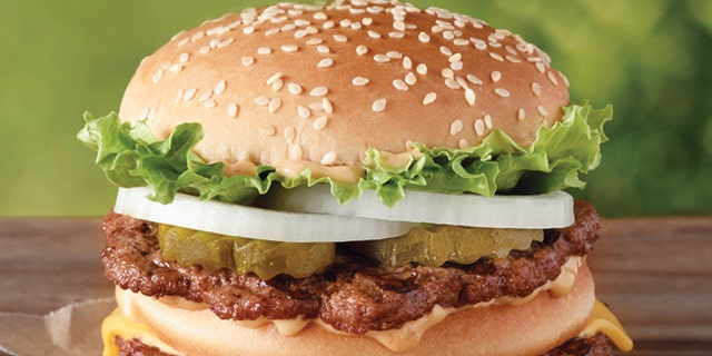 """This undated image provided by Burger King shows the """"Big King"""" sandwich. Burger King says it's an addition to the permanent menu rolling out this week."""