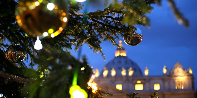 The Vatican Christmas tree is lit up after a ceremony in Saint Peter's Square at the Vatican December 14, 2012.