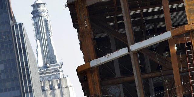 The Empire State Building is seen as construction continued in 2006 on the 30 Hudson Yards building.