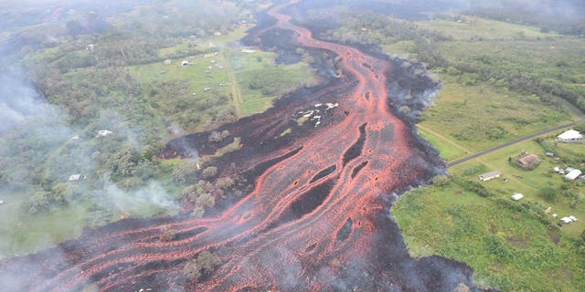 """Fast-moving"" lava flows threatened to cut off a major escape route for Puna residents."